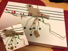 Corrugated Cardboard Bird Gift Wrapping by Beth Sumerlin O'Briant. (Picture only - no blog, just her Flickr Album) She linked to where you can find the paper bird pattern. Actual photo source here... https://www.flickr.com/photos/bethobriant/12151292913