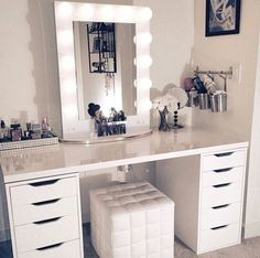 makeup, white, and room image. Love the easycare glossy surface, ottoman that can be stored out of the way, and the storage cabinets. Very efficient.