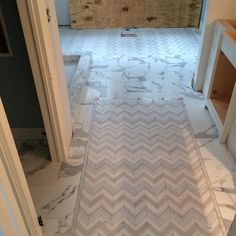 Mosaic game turned up. Calcutta gold marble with two custom white thassos/carrera/mother of pearl chevron inlays bordered with a mother of pearl liner...... This jobs just gettin warmed up. @kurrle727  #casebuilders #newravenna #newravennamosaics @ctmarble #marble #mosaic #tile #masterbathroom #schluter #ditraheat #tilelife