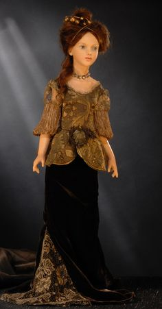 """collection-2011 Helena, She is an elegant young lady, representing the"""" Haute Couture Française"""", in differents outfits. She is free standing, wearing high heeled precious shoes. Two hair styles , with a light brown mohair. She is 24 inches high. Edition of 10 pieces from the original sculpt only."""