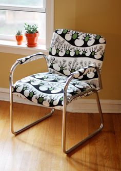 I see tons of these old chairs at thrift stores. Check out this great makeover. The fabric isn't exactly my thing, but how fun to turn it from office drab to fab. Seems like it was pretty easy to do as well. From HowAboutOrange blog.