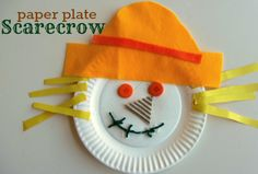 paper plate scarecrow craft  Gather your materials. You will need a paper plate, crayons,  glue, scissors, yarn, buttons, some textured paper , felt and  yellow construction paper. I had popsicle sticks for hair but as you will see they didn't work out.