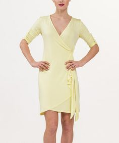 Love this Pale Lime Yellow Roll-Tab Sleeve Wrap Dress - Women by Biacci on #zulily! #zulilyfinds