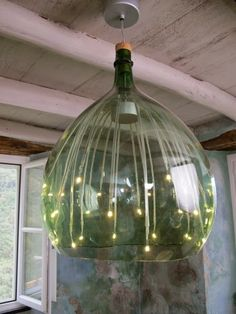 Brian Boitano Decorator.  Chandelier was made from a huge wine jug found on the property - a fixture from Ikea was put inside the glass