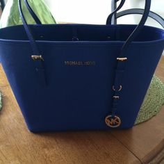 Michael Kors navy blue tote Beautiful tote only used it a couple of times. Still in great condition Michael Kors Bags Totes