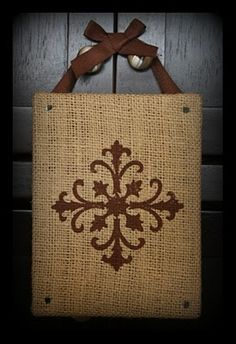 Hot glue burlap to a canvas and use a stamp or stencil to make a design or monogram.