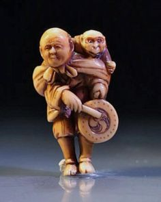 Japanese Carved Ivory Netsuke of a Sarumawashi - Signed - May 2013