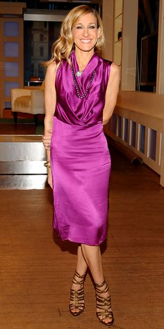 Sarah Jessica Parker in a purple dress and gold accessories