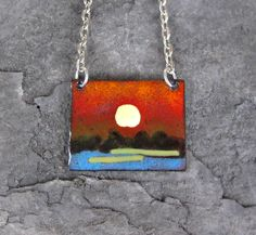 sunset necklace 1 inch by 1 1/4 inch white gold plated chain $45 www.torchedstudio.com
