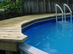 Do you need some inspiration for pool deck designs? 20 awesome above ground pools with decks, showcasing the myriad shapes and styles available on a budget. Above Ground Pool Landscaping, Small Backyard Patio, Backyard Patio Designs, Backyard Pergola, Backyard Pools, Pergola Ideas, Cheap Pergola, Landscaping Design, Pergola Plans