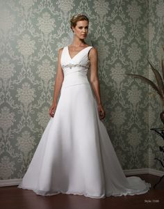 could be flattering with the pleated bodice and diagonal strips on the back.  Like that its not strapless!