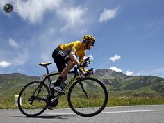 Sky Procycling rider and leader's yellow jersey Wiggins of Britain cycles in the Alps mountains during the eleventh stage of the 99th Tour de France cycling race between Albertville and La Toussuire. BOGDAN CRISTEL/REUTERS