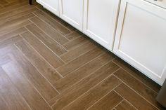 """The floors look like wood but it is actually tile.  We had the tile laid in a herringbone pattern which really looks cool.  The tile is made by Arizona tile and is called """"Misingi Suber""""."""