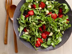 Sunny's simple Strawberry-Arugula Salad is drizzled with a citrus vinaigrette.