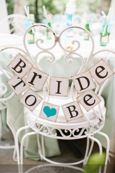 bride to be banner sign for the brides seat at a bridal shower bridal shower chair