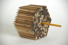 Stuart White - Self initiated project transforming the functional use of the ikea pencil into a creative tool by using it to make mass-produced prints, mimicking an assembly line.  Stuart White 2006.  https://vimeo.com/5991801