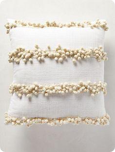 No-Sew Pom Pom Pillow Cover Ikea pillow cover. Glue strings of pom poms on.