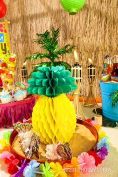 This Pineapple Centerpiece is the perfect touch for your next luau-themed event.