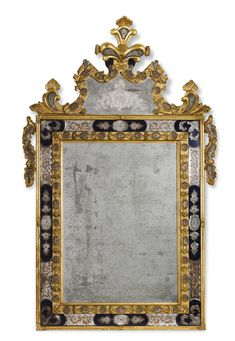 An Italian engraved clear and blue glass carved giltwood mirror in Venetian baroque style, 19th Century, incorporating 18th century elements the rectangular mirror plate surrounded by a punched gilt border with glass rosettes and outer borders with shaped mirror panels and blue glass inserts, the shaped cresting etched with a Doge's coat-of-arms and carved with shell and foliate motifs; rebacked