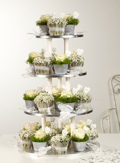 interesting concept -- stacked small arrangements --Favourite Favours | http://souk.oasisfloral.com