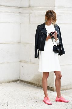 I love the mix of casual/tech footwear paired with the dress and then topped off with a Moro-jacket in leather. Mixing and matching.