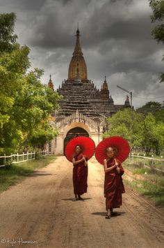 Buddhist Monks at Bagan, Burma.with their red umbrellas, these are two spiritual younger fellas