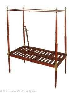 Antique Salesman's   Sample Campaign Bed Circa 1800   Miniature of a bed. Base folds in half for transport and has slots for the other parts. Legs and upper are fitted into brass slots. Brass slots have drilled dots to indicate which leg goes where.