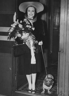 1939 Joan Crawford stepping off a train in New York with her dog