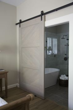 Master bathroom remodel, barn door, shower, free standing bath tub | Interior design -er: Carla Aston - Photographer: Tori Aston http://ToriAston.com