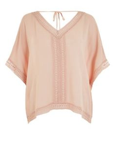 This Shell Pink Crochet Trim Dip Hem V Neck Top will keep you cool as the scene hots up. #newlook #fashion #festival