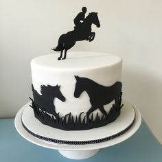Silhouette cake 4-layer dark chocolate mud filled with raspberry butter cream covered in fondant with hand cut horse silhouettes topped with a custom topper from Design@409