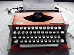 Great Vintage Orange Manual Typewriter Olympia by OldTypewriters