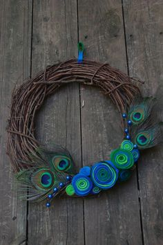Peacock Wreath....have peacock decorative balls etc to go with this--can incorporate yarn in the right colours that I have as well