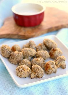 Crispy Baked Mushrooms - The Girl Who Ate Everything.  We made these as a side with the bakes pesto chicken and served with a side of marinara to dip them in.  I cut the mushrooms in quarters ans dipped them in milk and them into the breadcrumb mixture. I still don't totally like mushrooms, but this was a good recipe to get me to eat some. J loved it!