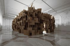 He is called a Sound Explorer.  What an amazing title.  He uses simple cardboard structure to make complex sounds.  Its like listening to the ocean.  Its great.