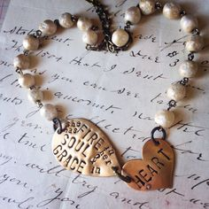 Items similar to She Has Fire In Her Soul & Grace in Her Heart Hand Stamped Message - Inspirational Necklace by Kris Lanae on Etsy Heart Hands, Hand Stamped, Fire, Bracelets, Handmade, Stuff To Buy, Etsy, Vintage, Inspiration