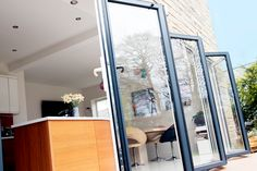 What You Need To Know About Bi-Fold Doors Now that the summer is finally here, we state to look at ways in which we can enjoy the summer and the warm outdoors. Folding Doors, Door Opener, Home Improvement, Windows, Mirror, Furniture, Home Decor, Accordion Doors, Decoration Home