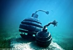 Time Bomb by Jason deCaires Taylor  Depth 6m, MUSA Collection, Punta Nizuc, Mexico