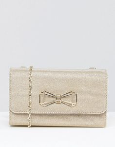 Don't forget to accessorize when you dress up that little black dress.  This little clutch is adorable and will be perfect to carry your lipstick and cell phone! The gold glitter sparkling bow will give you all the jewels you need! www.trendeetoad.com www.trendeetoad