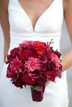 Bouquet with Red dahlias, red mini callas, red coxcomb, red mokara orchids, black baccara roses, and red coxcomb.