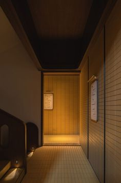 Dark corridors, atmospherically lit by recessed low-level lighting, are punctuated by walnut-framed doors fitted with frosted wire mesh glass. Yellow Tile, Pink Tiles, Wooden Facade, Chinese Interior, Earthy Color Palette, Bauhaus Style, Leather Headboard, Space Photography, Chengdu