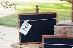 Make your own chalk board--2 x 12 square board, a finial, woodstain, and some chalkboard paint is all it takes.  Makes a nice gift, too.