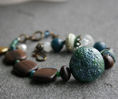 Teal Sea Urchin Gemstone Lampwork Glass and Wood Bracelet Sky Blue and Wood Brown. $34.00, via Etsy.