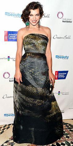 I love that green in her earrings | Milla Jovovich
