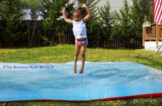 """Go Kid Yourself: Giant Squishy Sensory Bag -- Just clear plastic sheeting (like a big painter's tarp), duct tape, food coloring, and water. Could also throw in a few random flat toys or leaves or whatnot for a more traditional """"sensory bag"""" experience. Awesome!"""