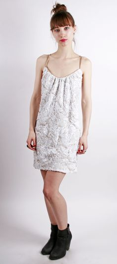 Beautiful ivory sequined mini dress with nude spaghetti straps by Dress of Population.
