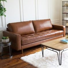 The mid-century style of this camel top grain leather sofa is showcased by its sleek lines and oak wood legs. The camel leather upholstery on this couch is a neutral palette for your favorite living room color scheme and high density foam cushions are com Living Room Furniture, Living Room Decor, Living Rooms, House Furniture, Kitchen Living, Diy Kitchen, Living Area, Brown Sofa, Brown Leather Sofa Living Room