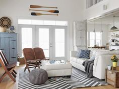 :: Get Your Pouf On :: Nautical themed living rooms. Our favorite is the first photo of the series (not shown here) with the dark wood flooring and the turquoise walls