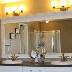 How to Upgrade your Builder Grade Mirror - Frame it! Cost us around $30. MDF and moulding.