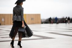 Alexandra Rakhimova wearing a Dior hat, Saint Laurent bag and Gianvito Rossi ankle boots after the Elie Saab Spring 2015 Haute Couture fashion show in Paris, France